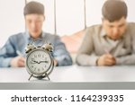 vintage alarm clock with men... | Shutterstock . vector #1164239335