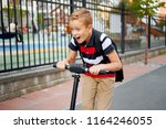 school boy in riding with his...   Shutterstock . vector #1164246055