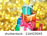 pile of small gifts on gold...   Shutterstock . vector #116425045
