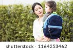 mother was carrying a child in...   Shutterstock . vector #1164253462