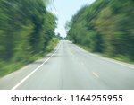 asphalt road in forest at the... | Shutterstock . vector #1164255955