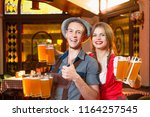 cheerful man and girl waiters... | Shutterstock . vector #1164257545