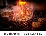 burger barbeque being cooked on ... | Shutterstock . vector #1164264562