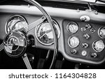 Stock photo steering wheel and dashboard in historic vintage red car retro automobile interior scene old 1164304828