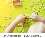 a small child plays with... | Shutterstock . vector #1164335962