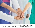 medical people handshaking... | Shutterstock . vector #1164347695