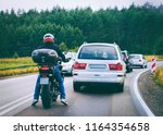 motorcycle and cars in a... | Shutterstock . vector #1164354658