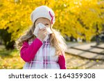girl child with cold rhinitis... | Shutterstock . vector #1164359308