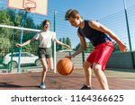 teen boy coaching his... | Shutterstock . vector #1164366625