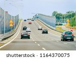 scenery with car on the highway ... | Shutterstock . vector #1164370075