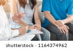 patient couple consulting with... | Shutterstock . vector #1164374962