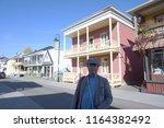 a man standing at rue saint... | Shutterstock . vector #1164382492