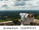 looking out from a telescope... | Shutterstock . vector #1164395215