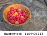 big pile of fresh raspberries... | Shutterstock . vector #1164408115