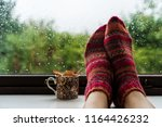 Woman Feet In Warm Wool Socks...