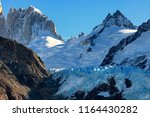 sharp and cold peaks of glaciar ... | Shutterstock . vector #1164430282