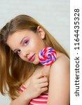 girl with big lollipop  sweet... | Shutterstock . vector #1164435328