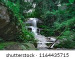 the waterfall nature view... | Shutterstock . vector #1164435715