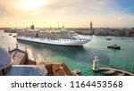 oversized cruise ship brings... | Shutterstock . vector #1164453568