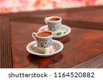 two traditional porcelain... | Shutterstock . vector #1164520882