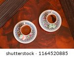 two traditional porcelain... | Shutterstock . vector #1164520885