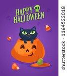 a cute black cat on a halloween ...   Shutterstock .eps vector #1164523018