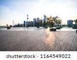 empty square with city skyline... | Shutterstock . vector #1164549022