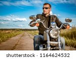 biker man wearing a leather... | Shutterstock . vector #1164624532