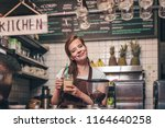 young girl with smoothie in the ... | Shutterstock . vector #1164640258