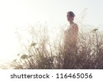 Young girl portrait in backlight. - stock photo