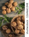 walnuts in wooden bowl. whole... | Shutterstock . vector #1164661348