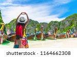 happy traveler woman on summer... | Shutterstock . vector #1164662308