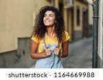 young arab tourist woman with... | Shutterstock . vector #1164669988