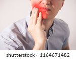 man suffering from a toothache... | Shutterstock . vector #1164671482