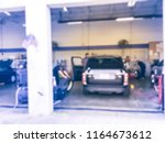 abstract blurred auto repair ... | Shutterstock . vector #1164673612