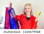 beautiful blonde female... | Shutterstock . vector #1164679468