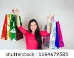 beautiful happy brunette female ... | Shutterstock . vector #1164679585