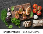 grilled sausages with rye bead... | Shutterstock . vector #1164690898
