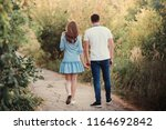 young loving couple standing... | Shutterstock . vector #1164692842