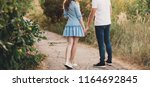 young loving couple standing... | Shutterstock . vector #1164692845