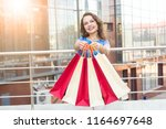consumerism  sale and people... | Shutterstock . vector #1164697648