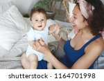 top view of caring loving young ... | Shutterstock . vector #1164701998