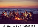 a group of friends using cell... | Shutterstock . vector #1164702925