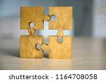 4 four brown pieces of puzzle... | Shutterstock . vector #1164708058