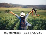asian woman traveler with... | Shutterstock . vector #1164727252