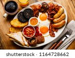 full fry up english breakfast... | Shutterstock . vector #1164728662