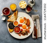 full fry up english breakfast... | Shutterstock . vector #1164729202