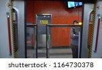 subway train doors opening  ... | Shutterstock . vector #1164730378