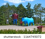 Small photo of Bemidji, Minnesota - July 24, 2018: Paul Bunyan and Babe the Blue Ox, popular, often photographed road side attraction statues of the legendary lumberjack and his sidekick.