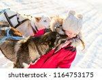 adorable girl having a cuddle... | Shutterstock . vector #1164753175